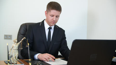 Serious handsome businessman reading and signing contract Footage