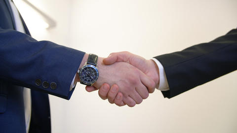 Close up view businessmen shaking hands after successful deal Live Action