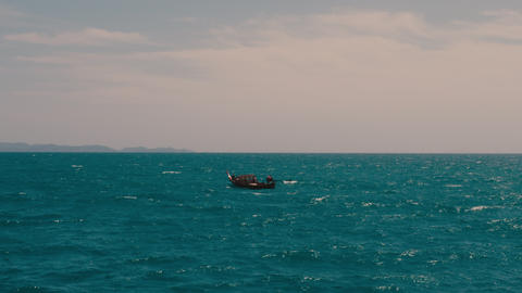 view of small fishing boat floating in the sea GIF