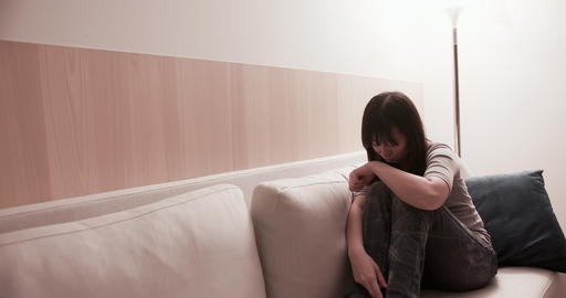woman feel depressed on sofa Live Action
