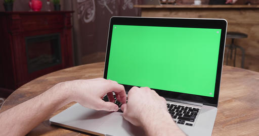 Parallax POV footage of male hands working on computer with green screen Footage