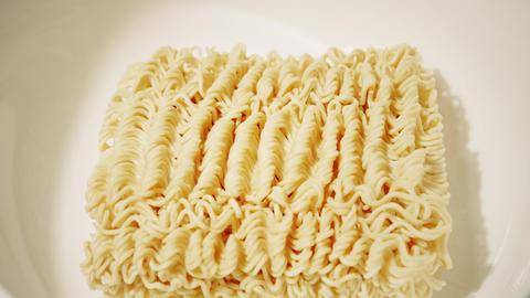 Cooking instant noodles soup, slow motion close-up shot GIF
