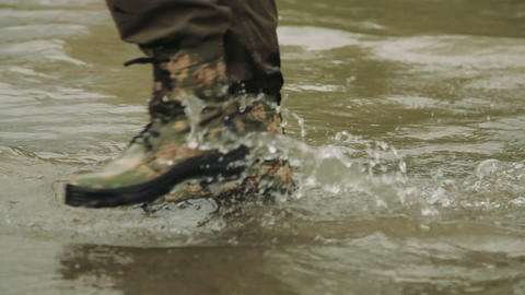 A hunter goes in army boots Footage