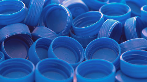 Blue plastic bottle caps. Studio shot. Plastic waste Footage