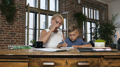 Beautiful grandma teaches of his lovely teen grandson to write homework that the Footage