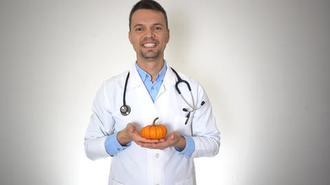 Doctor Holding Natural Organic Pumpkin, Healthy Vitamin Nutrition Concept Live Action