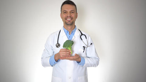 Doctor Holding Natural Organic Broccoli, Healthy Vitamin Nutrition Concept Live Action