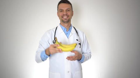 Doctor Holding Natural Organic Banana, Healthy Vitamin Nutrition Concept Live Action