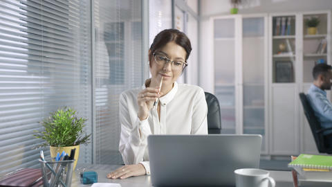 smiling employee reads email from a client an sales report on the market service GIF