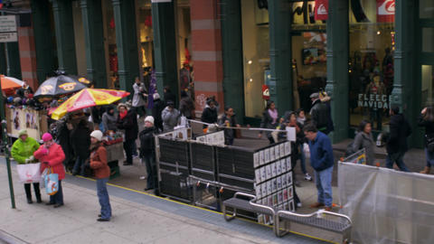 Dolly shot of pedestrians walking down the sidewalk with stands in New York City Footage