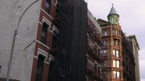 Dolly shot of old, big buildings in New York City Footage