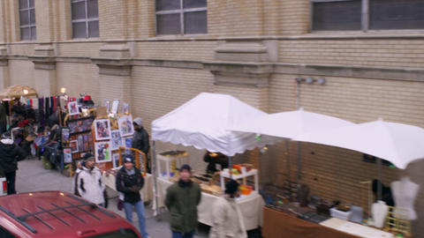 Dolly shot of street market in New York City Footage