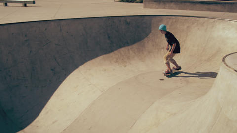 Shot of skater doing a frontside air in a bowl Footage