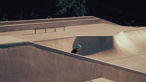Shot of skater attempting to 360 out of a ramp Footage