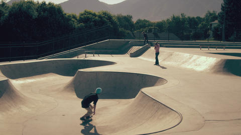 Shot of two skaters doing various tricks at the skatepark Footage