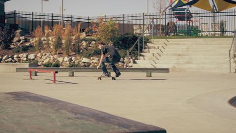 Panning shot of a skater doing various tricks at a skate park Footage