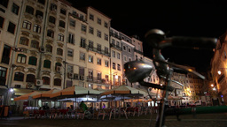 old bicycle parked in square at night, slider shot Footage