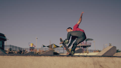 Shot of skater catching air out of a ramp at a skatepark Footage
