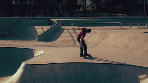 Shot of skateboarder doing a frontside 360 grab and falling Live Action