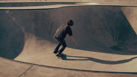 Shot of young skater rolling around in a skatepark Footage