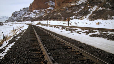 Tilt zoom shot of tracks and mountain Footage