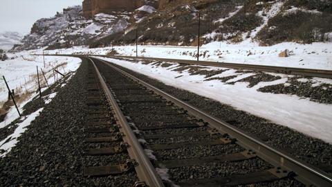 Tilting zoom shot of railroad tracks Live Action
