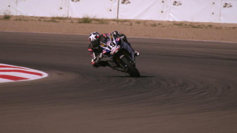 Slow motion footage of a motorcycle rider on a racetrack Footage