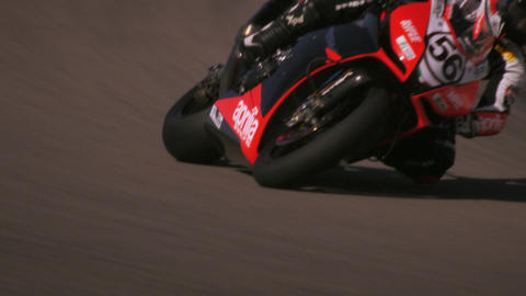 Slow motion footage of motorcycle racers on the race circuit Footage