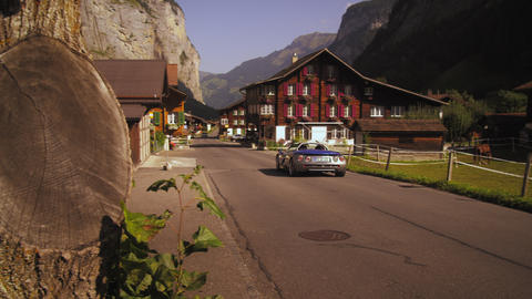 Convertible enters small Swiss village Footage