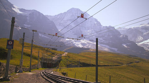 Swiss railway in front of Alps in Grindelwald, Switzerland Footage