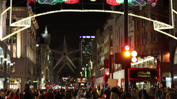 people walking on a street in London at Christmas time Footage