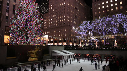 people skating on the ice rink at Rockefeller Center during Christmas epoch Footage