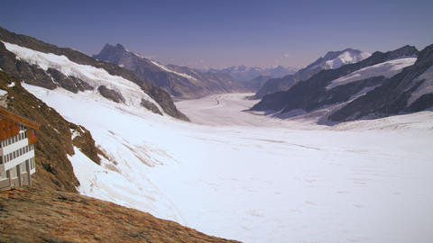 Panning shot of the alpine mountain range taken from a base camp Footage
