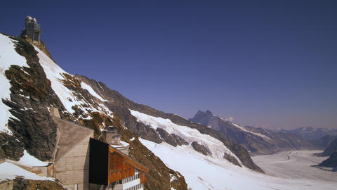 Static shot of the alpine mountain range taken from a base camp in Switzerland Footage