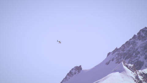 Shot of a helicopter flying over the Swiss alps Footage