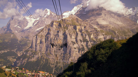 Tracking shot of the Swiss alps and the village at the foot of the mountain Footage