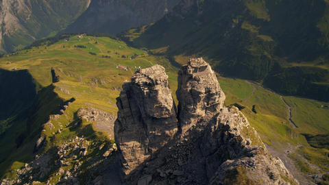 Descending dolly shot of rock formation near the Swiss alps Footage