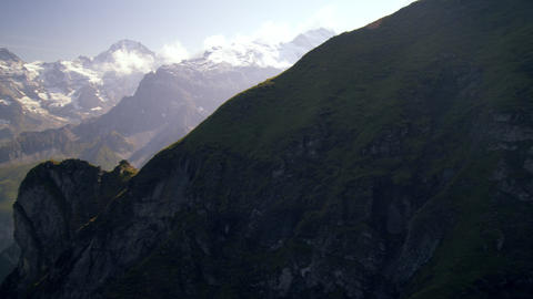 Descending dolly shot of the alps in Switzerland Live Action
