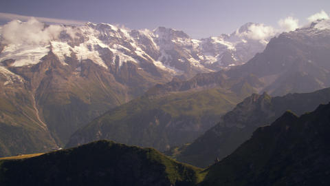 Panning shot of the beautiful Swiss alps Live Action