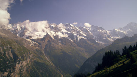 Dolly shot of the alps taken from an aerial tramway in Switzerland Footage