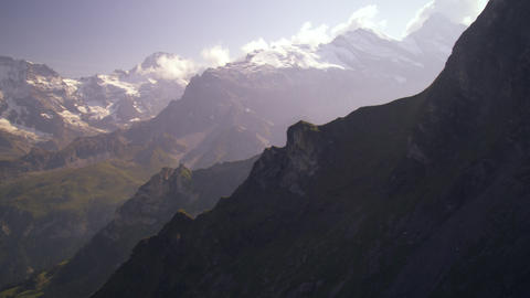 Panning shot of the wide expanse of the alpine mountain range in Switzerland Live Action
