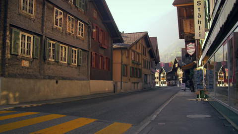 Cars traveling down Hauptstrasse road, Brienz, Switzerland Footage