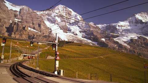 Pan of Swiss alps, train tracks, and hotel Footage