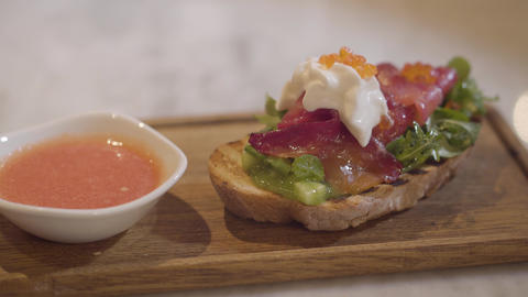 Appetizing of delicious bread with red fish, cream and red caviar on a wooden Live Action