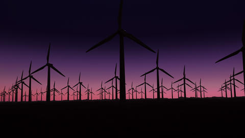 [alt video] silhouette of wind turbines at sunrise with copy space