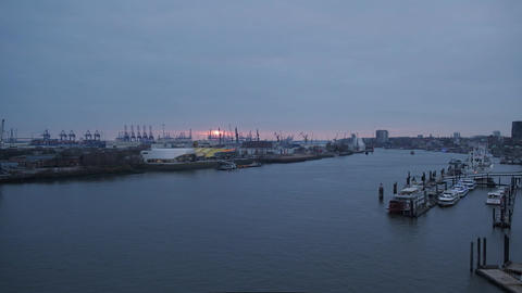 Harbor with beautiful sunset and loading cranes Footage