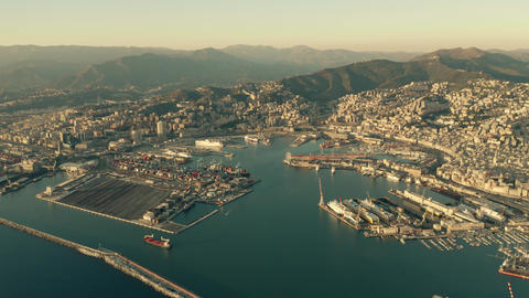 Aerial of seaport and cityscape of Genoa in the evening. Italy Footage