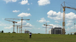 Construction Crane and Summer Sky Panorama With Man Walking Across Archivo