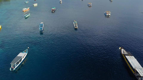 Tropical island aerial drone. Lombok, gili. Beautiful overview of the boats on Live Action