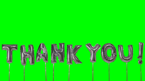 Word thank you from helium silver balloon letters floating on green screen Live Action